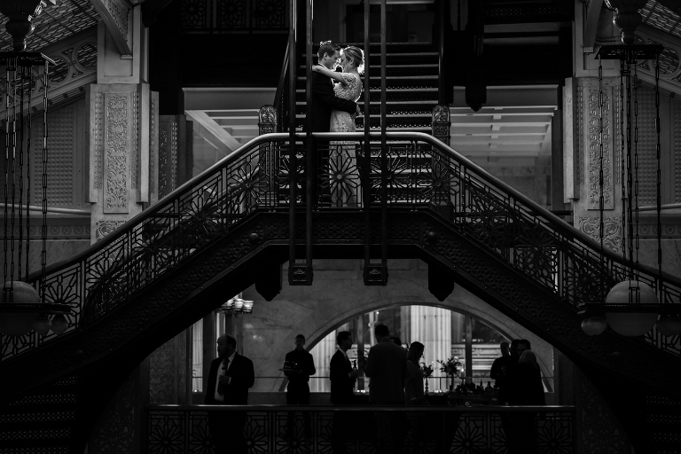 Bride and Groom on The Rookery staircase Chicago by Candice Cusic