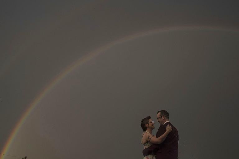 Bride and groom double rainbow