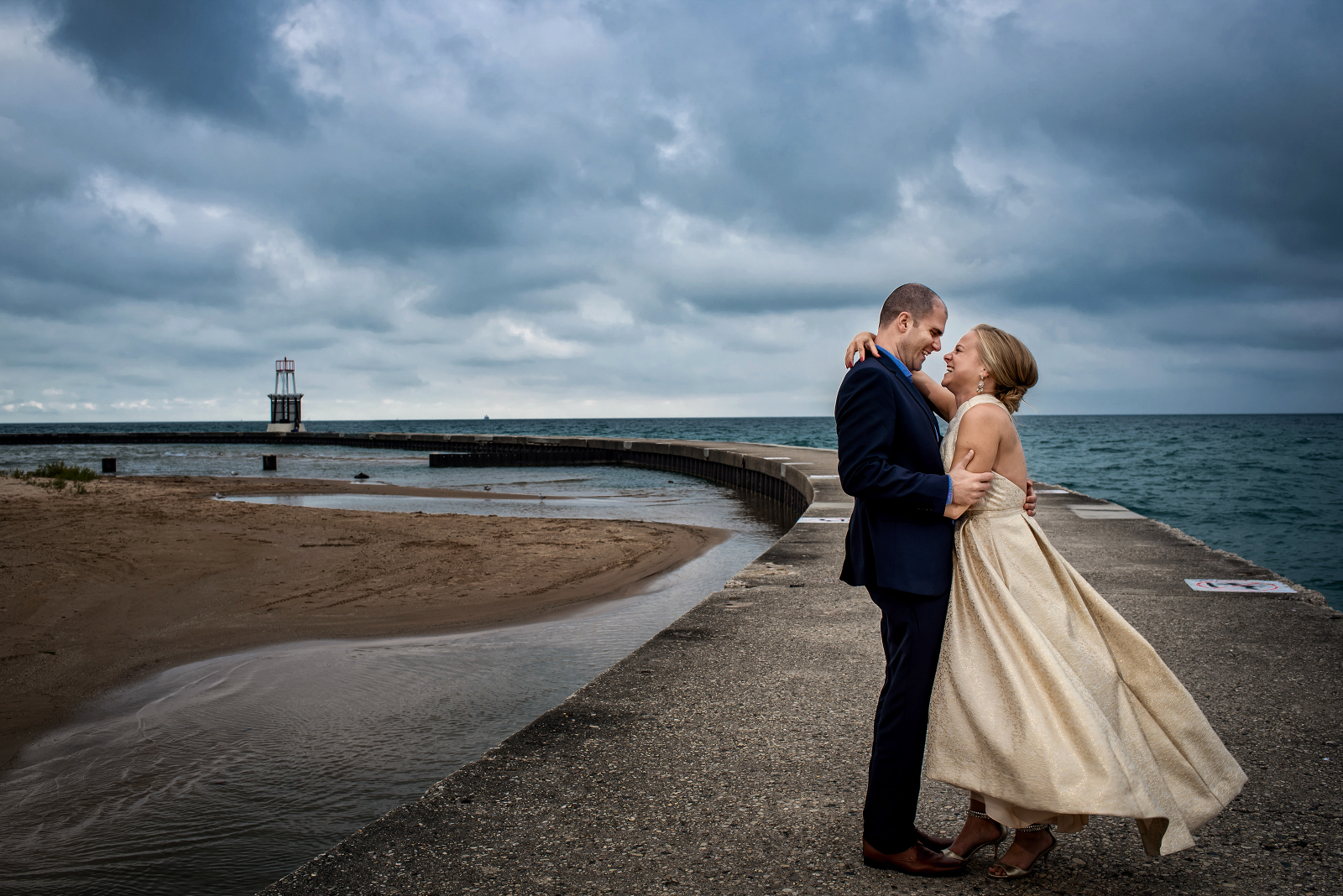 bride and groom gazing into each other's eyes by Lake Michigan. Photographed by Candice Cusic