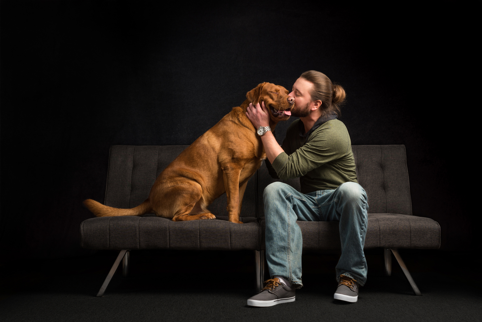 Dog Dad with Nershi on a couch during their pet photoshoot. Photographed by Candice Cusic